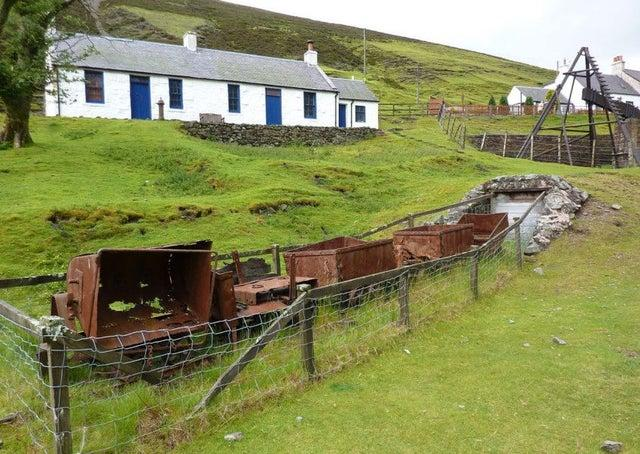 Residents of Scotland's highest village have voted in favour of plans for a community buyout