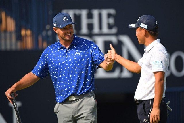 Bryson DeChambeau fist bumps Japan's Ryosuke Kinoshita after a practice round for the 149th Open at Royal St George's. Picture: Andy Buchanan/AFP via Getty Images.