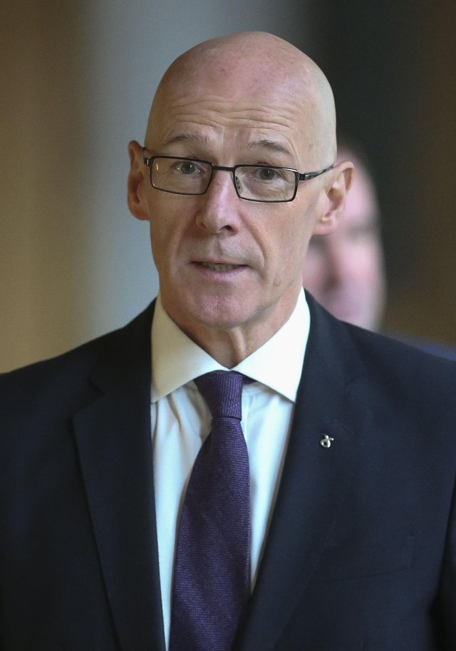 Deputy First Minister John Swinney is facing a vote of no confidence.