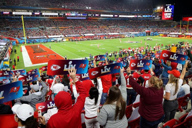 Fans hold up signs in the stands during Super Bowl LV between the Tampa Bay Buccaneers and the Kansas City Chiefs at Raymond James Stadium on 7 February 2021. (Pic: Getty Images)