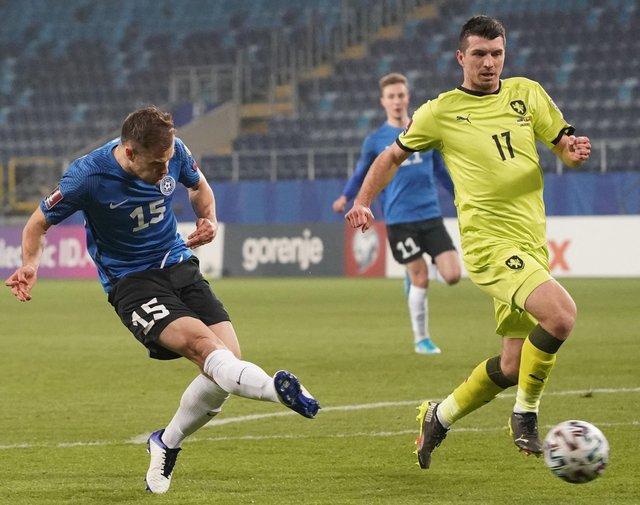 Estonia's forward Rauno Sappinen shoots past Czech Republic's defender Ondrej Kudela to score during the FIFA World Cup Qatar 2022 qualification Group E football match between Estonia and Czech Republic at the Lublin Stadium, in Lublin, Poland on March 24, 2021. (Photo by JANEK SKARZYNSKI/AFP via Getty Images)