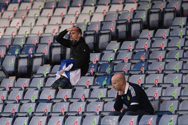 Scotland supporters react to the 3-1 defeat to Croatia at Hampden that ended their Euro 2020 hopes (Photo by STU FORSTER/POOL/AFP via Getty Images)