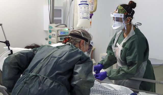 "NHS staff are ""tired and burdened"" John Swinney has said."