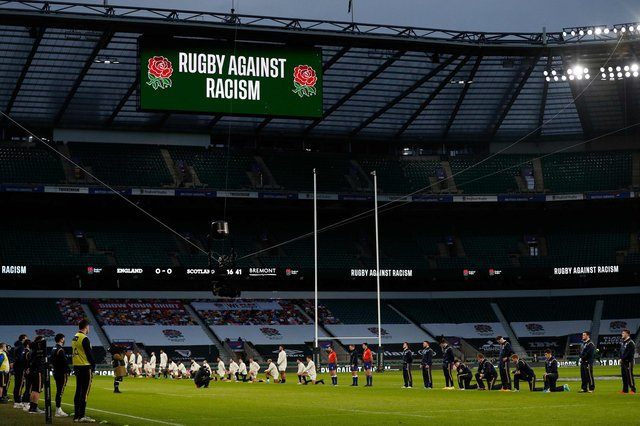 Some players stand and others take the knee ahead of the Six Nations between England and Scotland at Twickenham. Picture: Adrian Dennis/AFP via Getty Images