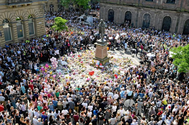 Members of the public observe a minute's silence in central Manchester in memory of the 22 people who were murdered in the Manchester Arena terrorist attack in May 2017 (Picture: Jeff J Mitchell/Getty Images)