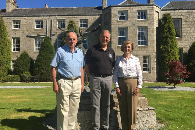 From left: Andrew Meiklejohn, Euan Shand and Linda Meiklejohn pictured outside The Castle Hotel. Picture: contributed.