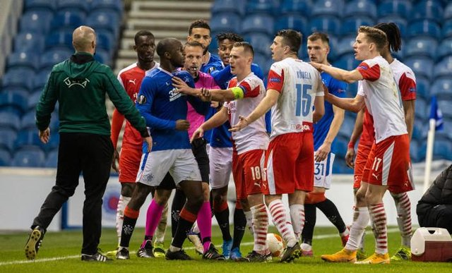 Rangers midfielder Glen Kamara reacts furiously to a comment from Slavia Prague's Ondrej Kudela in the closing stages of the Europa League match at Ibrox. (Photo by Alan Harvey / SNS Group)