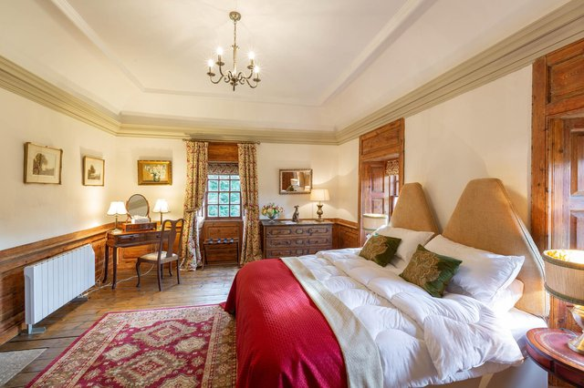 One of the four double bedrooms at Old Rowallan Castle.
