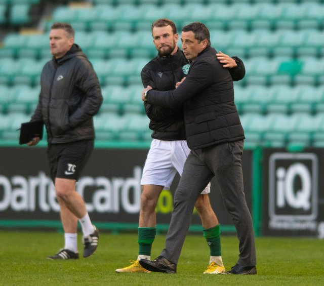 Hibs manager Jack Ross embraces Christian Doidge at full time.