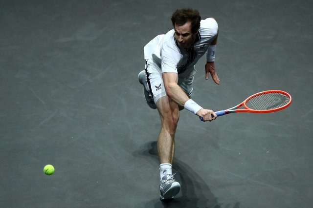 Andy Murray returns a backhand in his match against Andrey Rublev in the 48th ABN AMRO World Tennis Tournament in Rotterdam. (Photo by Dean Mouhtaropoulos/Getty Images)