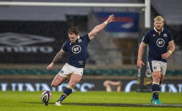Scotland captain Stuart Hogg unleashes a long-range kick during the win over England at Twickenham. Picture: Craig Williamson/SNS