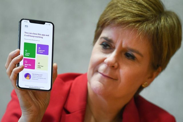 First Minister Nicola Sturgeon with the Protect Scotland app. (Photo by Jeff J Mitchell/Getty Images)