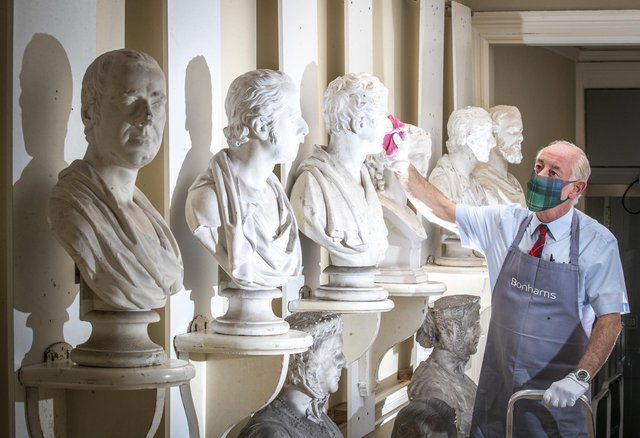 Danny McIlwraith inspects some of the Victorian marble and plaster busts on display at Bonhams Edinburgh during the Dunrobin Attic Sale, an auction of hundreds of items found in the attics and cellars at Dunrobin Castle.