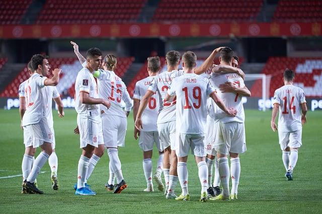 Alvaro Morata of Spain celebrates scoring a goal with team-mates.