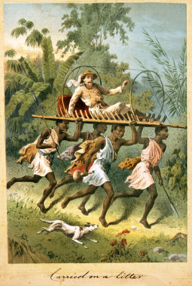 Circa 1850:  Bearers carry Dr Livingstone on a litter through the jungle.  (Photo by Hulton Archive/Getty Images)