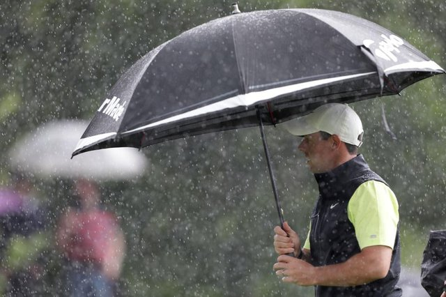 Rory McIlroy shelters unfer his umbrella during final round of the Dubai Duty Free Irish Open at Mount Juliet. Picture: Patrick Bolger/Getty Images.
