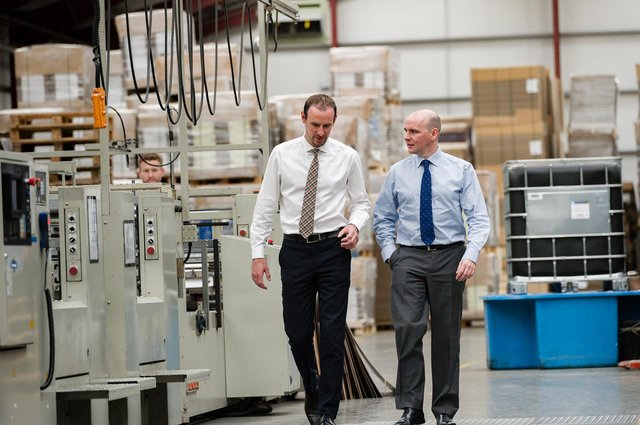 From left: McLaren Packaging directors and brothers Michael and Donald McLaren - the firm is eyeing further growth and reinvestment. Picture: Paul Hampton.
