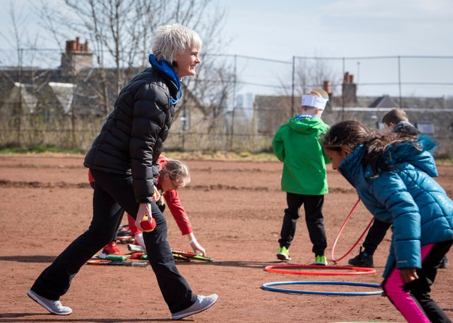Judy Murray giving children tennis training in Maryhill Park, Glasgow, as part of her work with the Judy Murray Foundation, which is aiming to breathe life into tennis courts that were restored by volunteers.