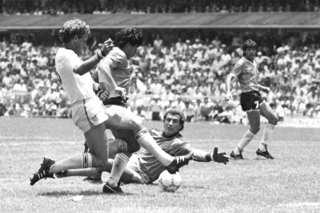 Diego Maradona scores the 'goal of the century' against England in the 1986 World Cup (Picture: AP Photo)