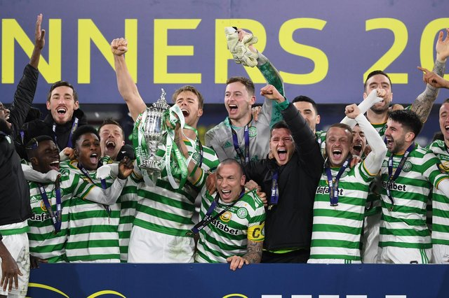 Celtic captain Scott Brown lifts the 2019/2020 Scottish Cup after the penalty shoot-out win over Hearts at Hampden. (Photo by Craig Foy / SNS Group)