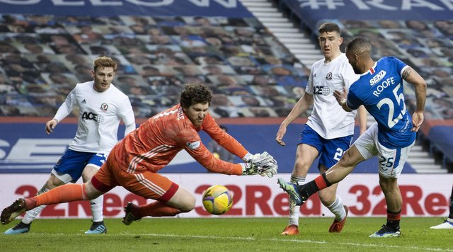 Kemar Roofe (R) makes it 2-0 during a Scottish Cup Third Round tie between Rangers and Cove Rangers at Ibrox Stadium, on April 04, 2021, in Glasgow, Scotland. (Photo by Alan Harvey / SNS Group)
