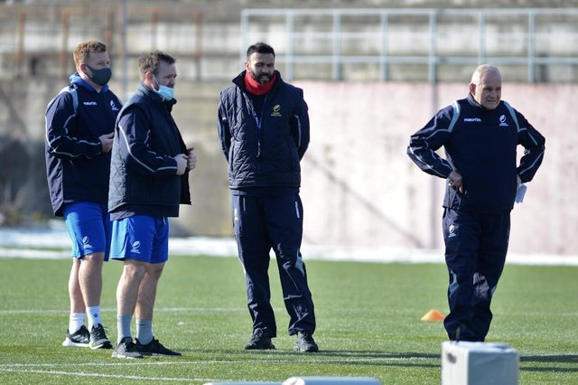 Romania's coaching team, from left: Analyst Paul Larter, forwards coach Steve Scott, backs coach Sosene Anesi and head coach Andy Robinson.