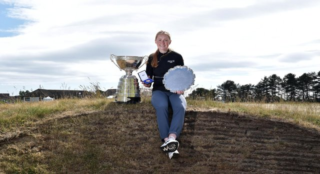 Louise Duncan poses with the Womens Amateur trophy following her 9&8 win over Iceland's Johanna Lea Ludviksdottir in the final of the R&A Womens Amateur Championship at Kilmarnock (Barassie). Picture: Charles McQuillan/R&A/R&A via Getty Images.