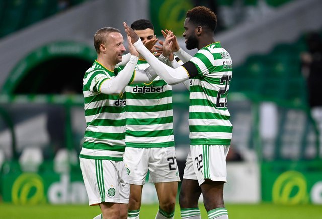 Odsonne Edouard celebrates with Leigh Griffiths after scoring to make it 2-0 to Celtic. Picture: SNS
