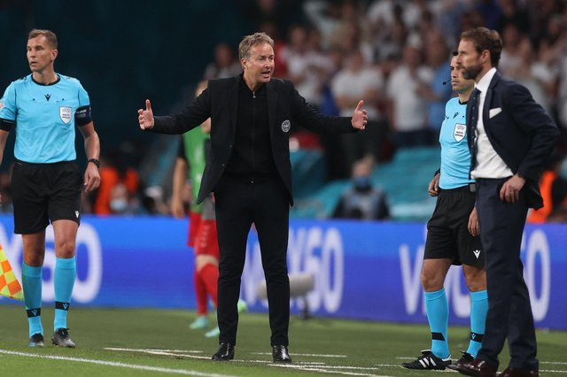 Denmark manager Kasper Hjulmand reacts during his side's controversial 2-1 extra-time defeat against England (Photo by CARL RECINE/POOL/AFP via Getty Images)