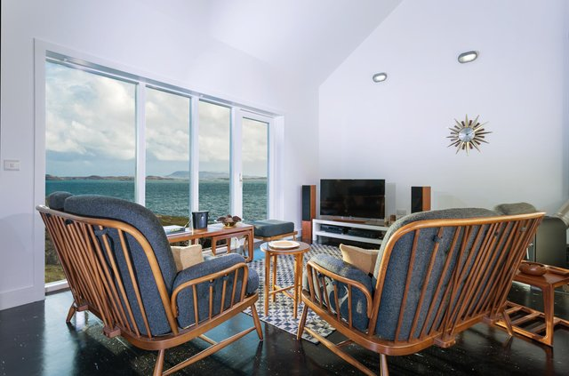 Image sitting back in your luxurious designer living room and enjoying these views at the Sound of Harris.