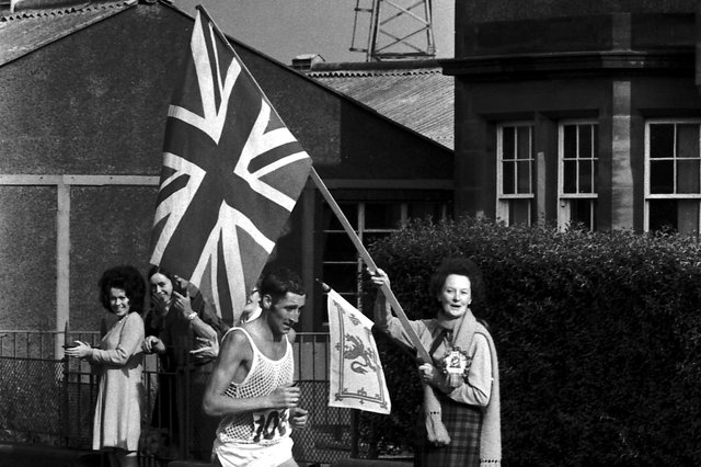 Ron Hill starts the climb at Portobello with flags flying - he went on to win Gold medal.