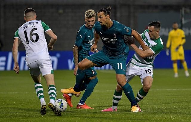 Hearts target Aaron McEneff (No.10) tussles with AC Milan's Zalatan Ibrahimovic earlier this season. Pic: Getty Images.