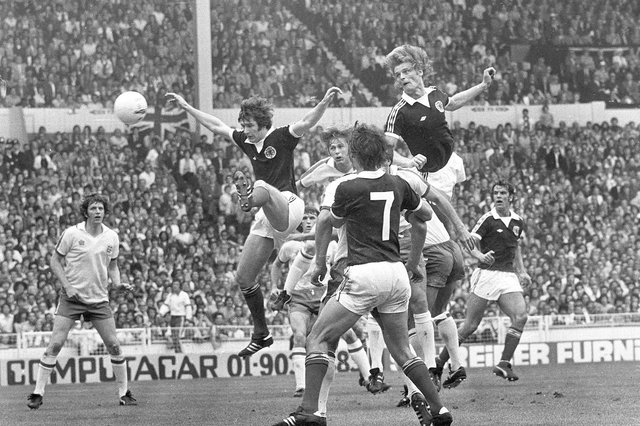 Gordon McQueen soars above the England defence to score in Scotland's victory at Wembley in 1977. Picture: Denis Straughan