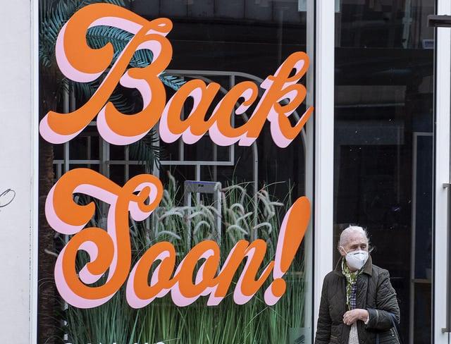 A shopper walks past a window display on Princes Street. Picture: Lisa Ferguson