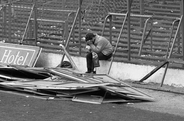 File photo dated 15/04/89 of a young Liverpool fan sitting with his head in his hands after the FA Cup Semi Final game between Liverpool and Nottingham Forest at Hillsborough.