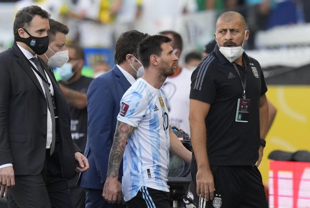 Brazil vs Argentina abandoned: Argentina's Lionel Messi walks off the field after the qualifying soccer match for the FIFA World Cup Qatar 2022 against Brazil was interrupted by health officials in Sao Paulo, Brazil on Sunday 5 September. (Image credit: AP Photo/Andre Penner)