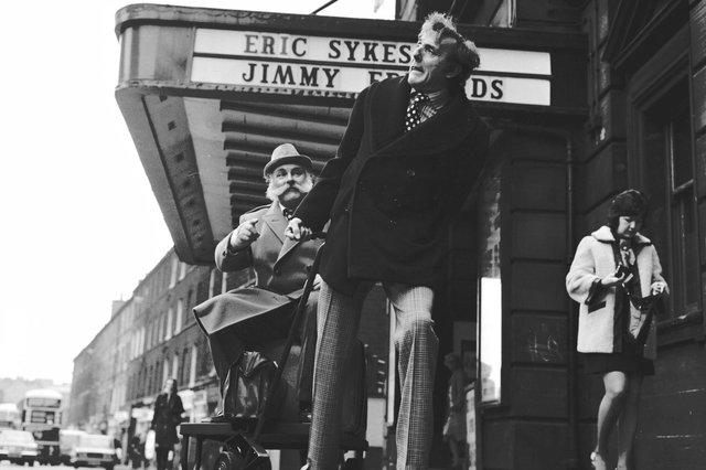 Actors and comedians Eric Sykes and Jimmy Edwards outside the King's Theatre, Edinburgh for Big Bad Mouse in February 1973.