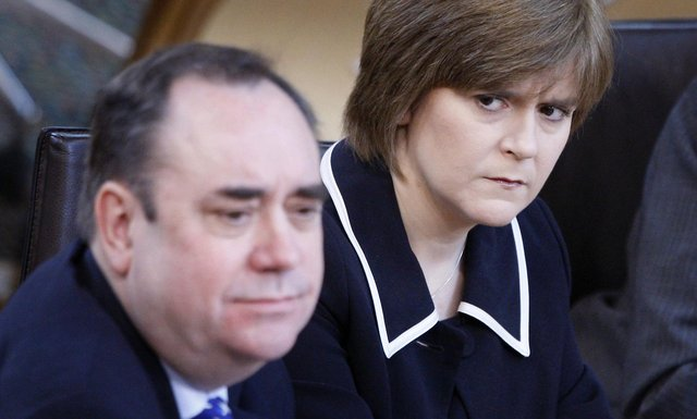 The then First Minister Alex Salmond and then Deputy First Minister Nicola Sturgeon are pictured in the Scottish Parliament in 2010 (Picture: Danny Lawson/PA Wire)