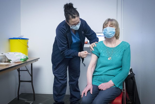 Nurse Sarah MacLeod, from the Vaccination Team, gives Margaret Swift, aged 69, from Balgreen, Edinburgh, her vaccine at the coronavirus mass vaccine centre at the Edinburgh International Conference Centre. Picture date: Monday February 1, 2021.