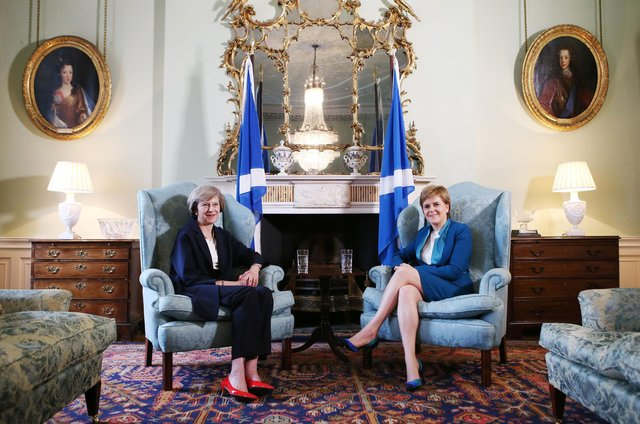 The Bute House Union Flag was apparently in the wash when Theresa May visited Nicola Sturgeon in 2016 (Picture: Getty)