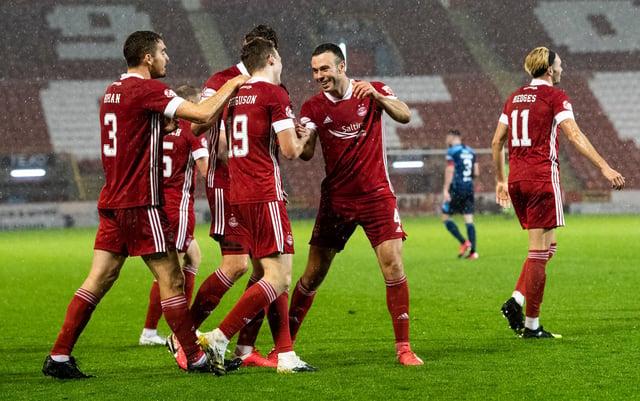 The Aberdeen players celebrate Lewis Ferguson's rocket. Picture: SNS