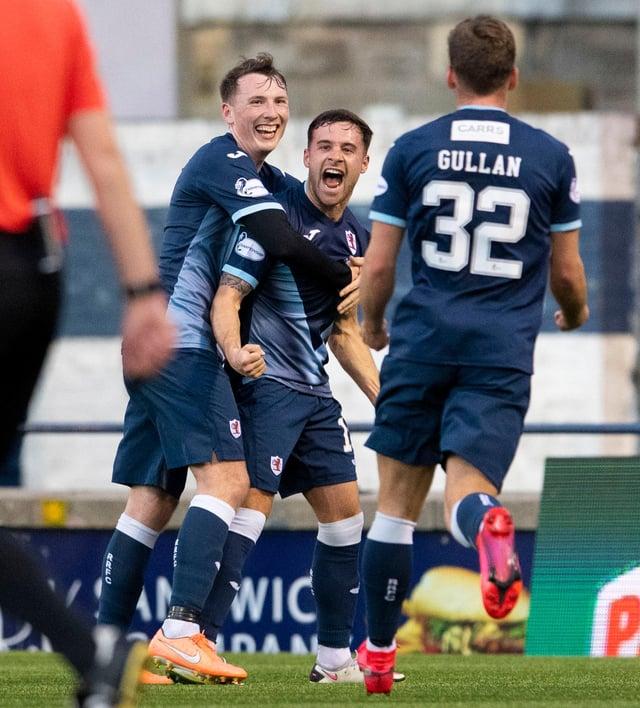 Lewis Vaughan, centre, celebrates scoring his second goal against Dunfermline.