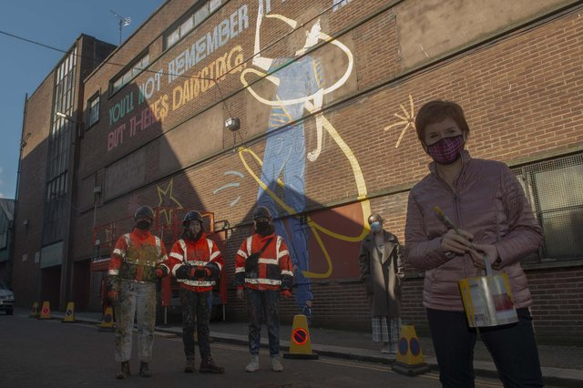 First Minister Nicola Sturgeon was at the Barrowlands in Glasgow to see the Shuggie Bain Mural painted by Artists Erin Bradley-Scott, Chelsea Frew and Kat Louden from the Cobalt Collective.