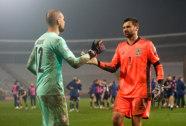 Scotland hero David Marshall consoles his Serbian counterpart Pedrag Rajkovic.