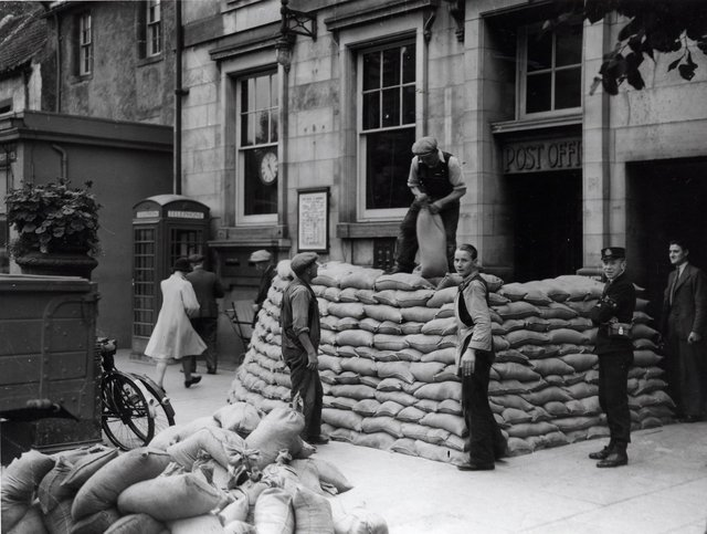 Soldiers from the 1st Parachute Brigade building defences outside the Post Office in South Street, St Andrews