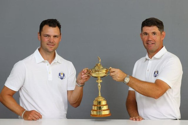 Martin Kaymer and Padraig Harrington pose with the Ryder Cup prior to the BMW International Open at Golfclub Munchen Eichenried in Munich. Picture: Andrew Redington/Getty Images.