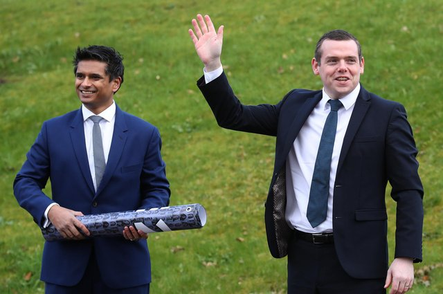 Scottish Conservative leader Douglas Ross with candidate Dr Sandesh Gulhane outside New Stobhill Hospital in Springburn, north Glasgow. Picture: Andrew Milligan/PA