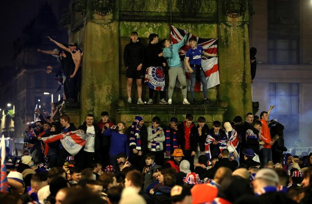 Rangers fans celebrate in George Square after Rangers win the Scottish Premiership title.