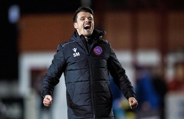 Steven Mackay celebrates Brora's shock 2-1 win over Hearts.