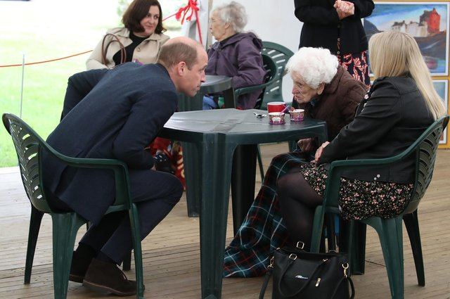 The Duke of Cambridge chats to Betty Magee, a resident of Queen's Bay Lodge Care Home in Edinburgh, and her granddaughter Kimberley Anderson during his visit. Picture: Andrew Milligan/PA Wire.